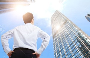 aa26121155-happy-successful-business-man-outdoors-Next-to-Office-Buildings-with-cityscape-and-sky-hong-kong-asi-Stock-Photo